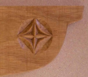 Carved shelf support for kitchen shelves